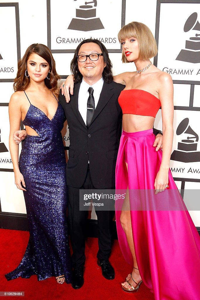 Recording artist Selena Gomez, music video director Joseph Kahn and Taylor Swift attend The 58th GRAMMY Awards at Staples Center on February 15, 2016 in Los Angeles, California.
