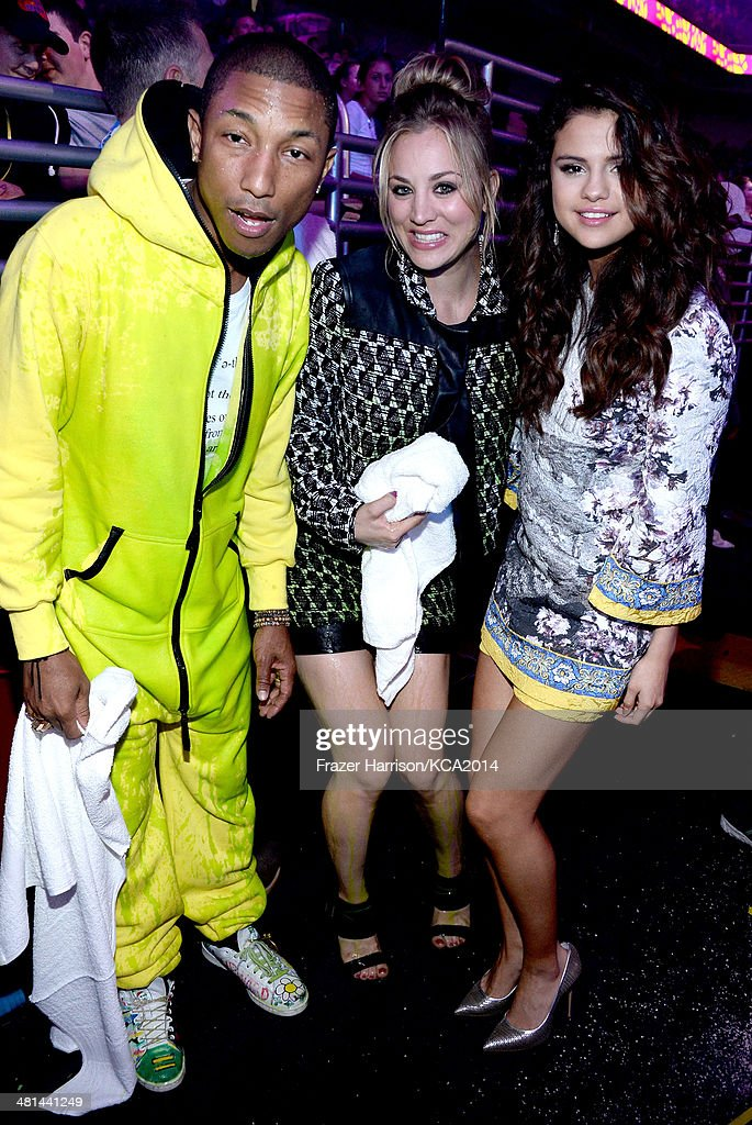 Recording artist Selena Gomez (R), recording artist Pharrell Williams (L) and actress Kaley Cuoco-Sweeting (C) attend Nickelodeon's 27th Annual Kids' Choice Awards held at USC Galen Center on March 29, 2014 in Los Angeles, California.