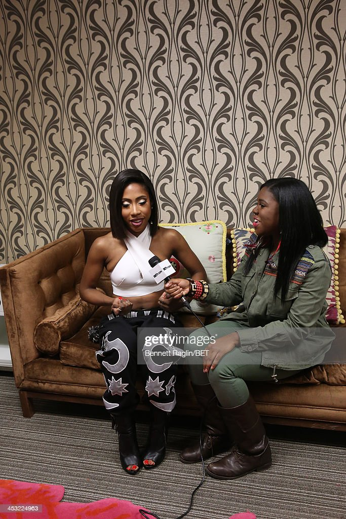 Recording artist Sevyn Streeter and BET.com host Nefertiti attend 106 & Park at BET studio on December 2, 2013 in New York City.