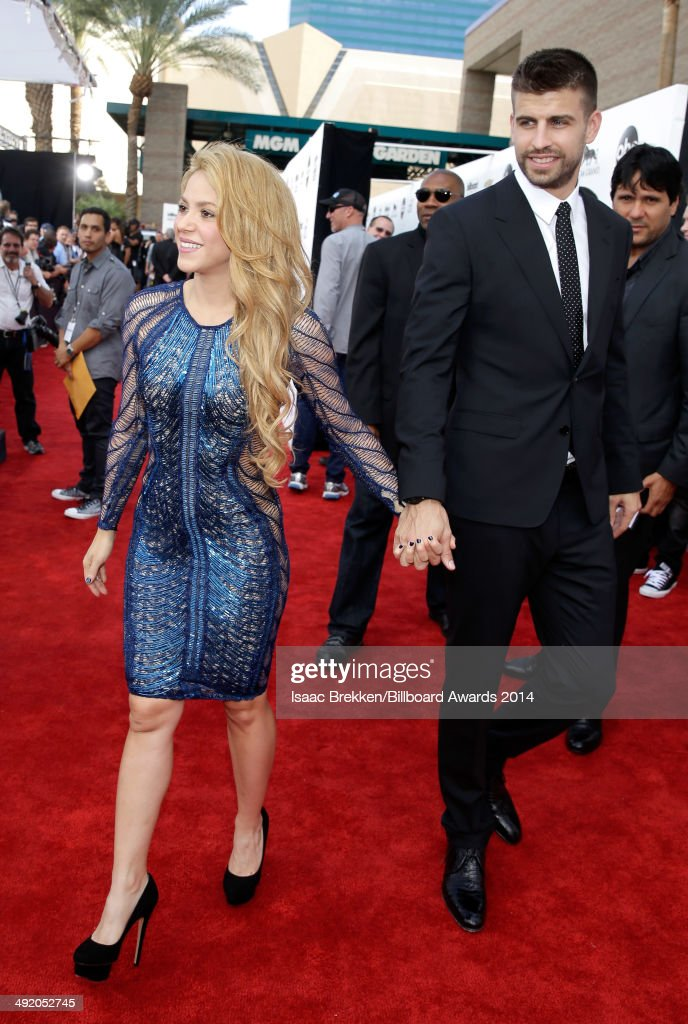 Recording artist <a gi-track='captionPersonalityLinkClicked' href=/galleries/search?phrase=Shakira&family=editorial&specificpeople=160650 ng-click='$event.stopPropagation()'>Shakira</a> and soccer player <a gi-track='captionPersonalityLinkClicked' href=/galleries/search?phrase=Gerard+Pique&family=editorial&specificpeople=227191 ng-click='$event.stopPropagation()'>Gerard Pique</a> attend the 2014 Billboard Music Awards at the MGM Grand Garden Arena on May 18, 2014 in Las Vegas, Nevada.
