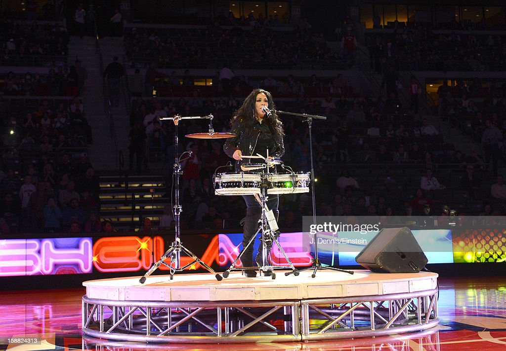 Recording artist <a gi-track='captionPersonalityLinkClicked' href=/galleries/search?phrase=Sheila+E.&family=editorial&specificpeople=242934 ng-click='$event.stopPropagation()'>Sheila E.</a> performs during the game between the Detroit Pistons and the Milwaukee Bucks on December 30, 2012 at The Palace of Auburn Hills in Auburn Hills, Michigan.