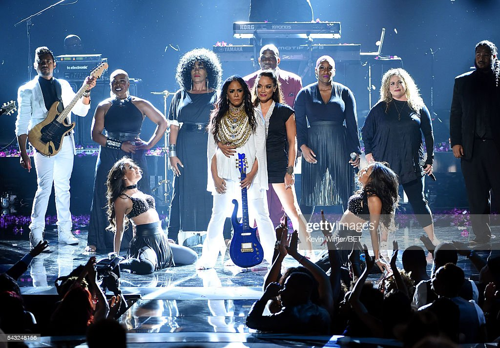 Recording artist <a gi-track='captionPersonalityLinkClicked' href=/galleries/search?phrase=Sheila+E.&family=editorial&specificpeople=242934 ng-click='$event.stopPropagation()'>Sheila E.</a> (C, holding guitar) performs onstage during the 2016 BET Awards at the Microsoft Theater on June 26, 2016 in Los Angeles, California.