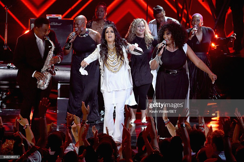 Recording artist <a gi-track='captionPersonalityLinkClicked' href=/galleries/search?phrase=Sheila+E.&family=editorial&specificpeople=242934 ng-click='$event.stopPropagation()'>Sheila E.</a> (C) performs onstage during the 2016 BET Awards at the Microsoft Theater on June 26, 2016 in Los Angeles, California.