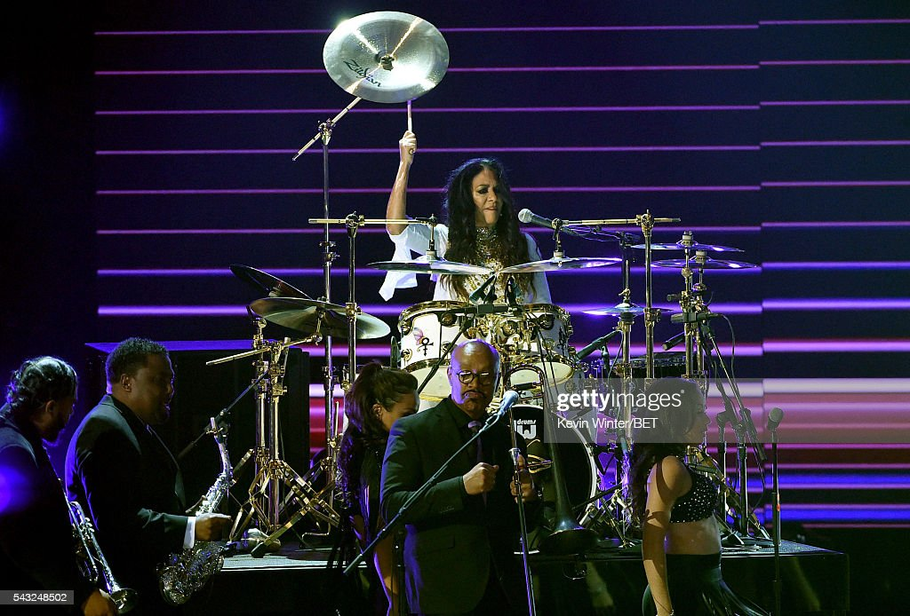 Recording artist <a gi-track='captionPersonalityLinkClicked' href=/galleries/search?phrase=Sheila+E.&family=editorial&specificpeople=242934 ng-click='$event.stopPropagation()'>Sheila E.</a> (C, at drum kit) performs onstage during the 2016 BET Awards at the Microsoft Theater on June 26, 2016 in Los Angeles, California.