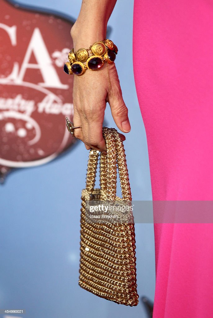 Recording artist Sheryl Crow (fashion detail) arrives at the American Country Awards 2013 at the Mandalay Bay Events Center on December 10, 2013 in Las Vegas, Nevada.