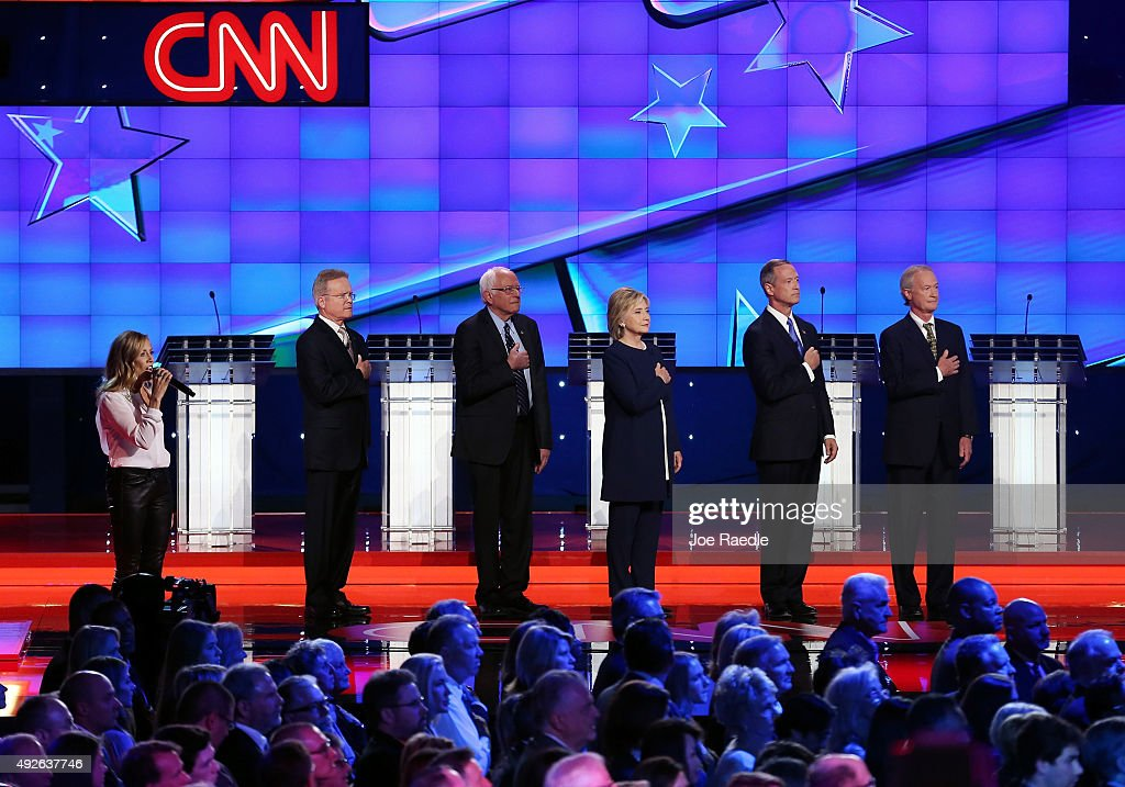 Recording artist Sheryl Crow sings the American national anthem as Democratic presidential candidates Jim Webb Sen Bernie Sanders Hillary Clinton...