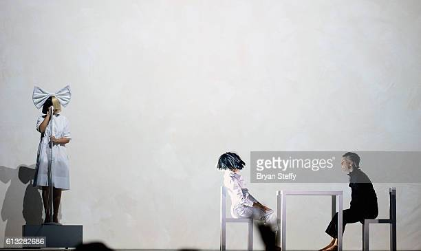 Recording artist Sia and dancers Maddie Ziegler and Wyatt Rocker perform during a stop of Sai's Nostalgic for the Present tour at the Mandalay Bay...
