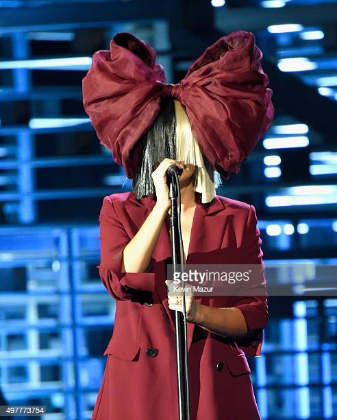 Recording artist Sia performs onstage at AE Networks 'Shining A Light' concert at The Shrine Auditorium on November 18 2015 in Los Angeles California