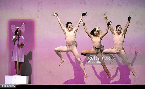 Recording artist Sia performs with dancers Nick Lanzisera Maddie Ziegler and Wyatt Rocker at the 2016 iHeartRadio Music Festival at TMobile Arena on...