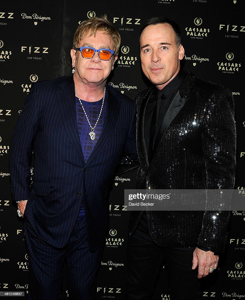 Recording artist Sir <a gi-track='captionPersonalityLinkClicked' href=/galleries/search?phrase=Elton+John&family=editorial&specificpeople=171369 ng-click='$event.stopPropagation()'>Elton John</a> (L) and his partner, Fizz Las Vegas creative director <a gi-track='captionPersonalityLinkClicked' href=/galleries/search?phrase=David+Furnish&family=editorial&specificpeople=220203 ng-click='$event.stopPropagation()'>David Furnish</a>, arrive at the grand opening of FIZZ Las Vegas inside Caesars Palace celebrating John's birthday on March 28, 2014 in Las Vegas, Nevada.
