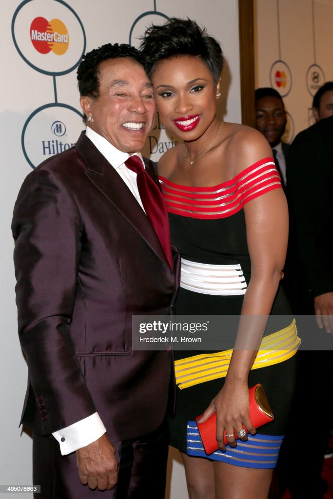 Recording artist Smokey Robinson (L) and recording artist/actress Jennifer Hudson attend the 56th annual GRAMMY Awards Pre-GRAMMY Gala and Salute to Industry Icons honoring Lucian Grainge at The Beverly Hilton on January 25, 2014 in Beverly Hills, California.
