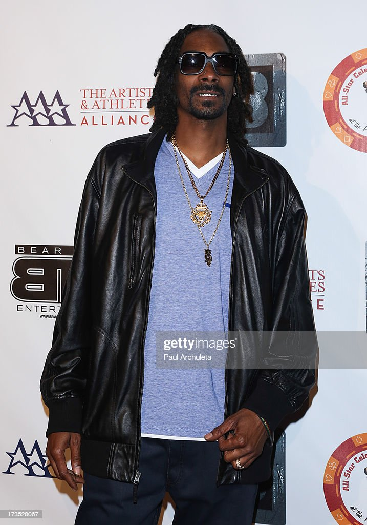 Recording Artist Snoop Dogg aka Snoop Lion attends the 8th annual BTE All-Star Celebrity Kickoff Party at The Playboy Mansion on July 15, 2013 in Beverly Hills, California.