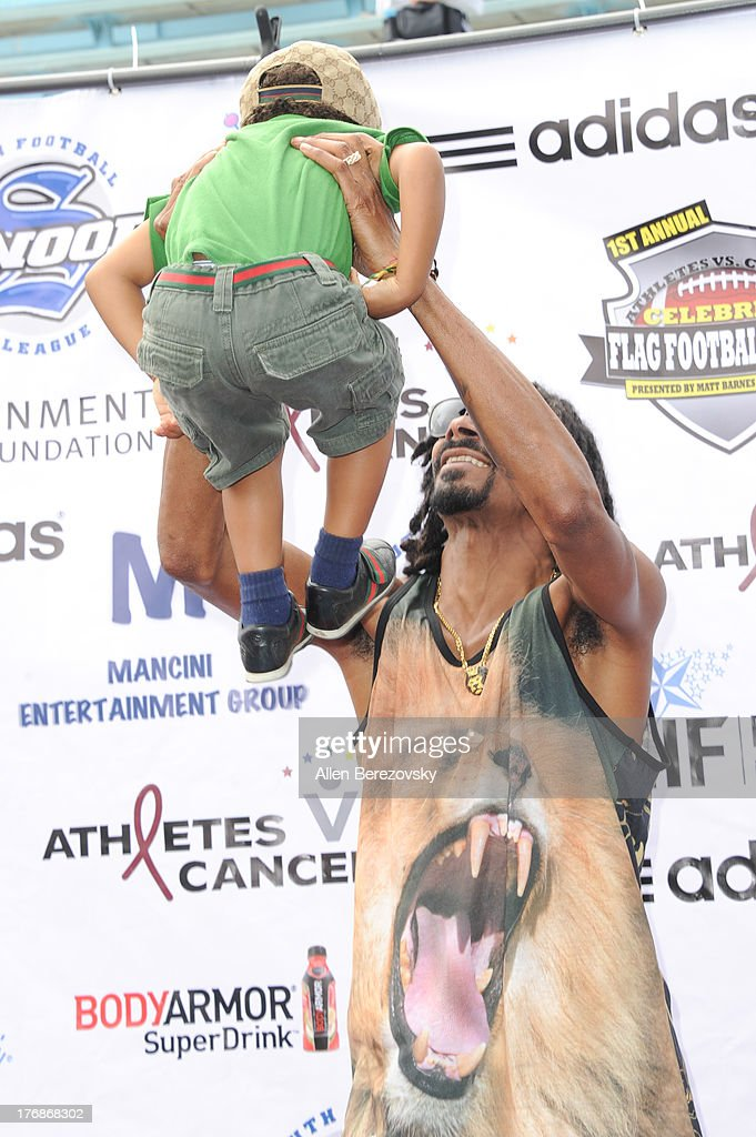 Recording artist Snoop Dogg and actor Elias Washington attend the 1st Annual Athletes VS Cancer Celebrity Flag Football Game on August 18, 2013 in Pacific Palisades, California.