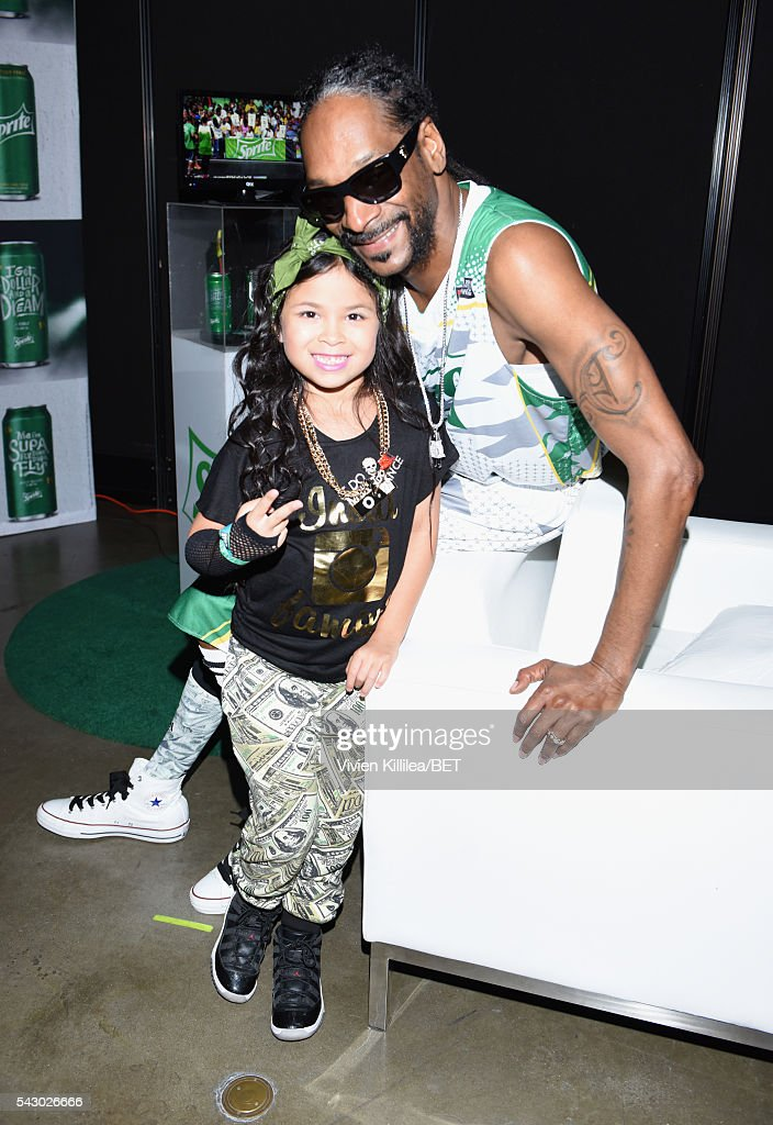Recording artist <a gi-track='captionPersonalityLinkClicked' href=/galleries/search?phrase=Snoop+Dogg&family=editorial&specificpeople=175943 ng-click='$event.stopPropagation()'>Snoop Dogg</a> (R) and guest are seen in the green room at the celebrity basketball game during the 2016 BET Experience at the JW Marriott Los Angeles L.A. Live on June 25, 2016 in Los Angeles, California.