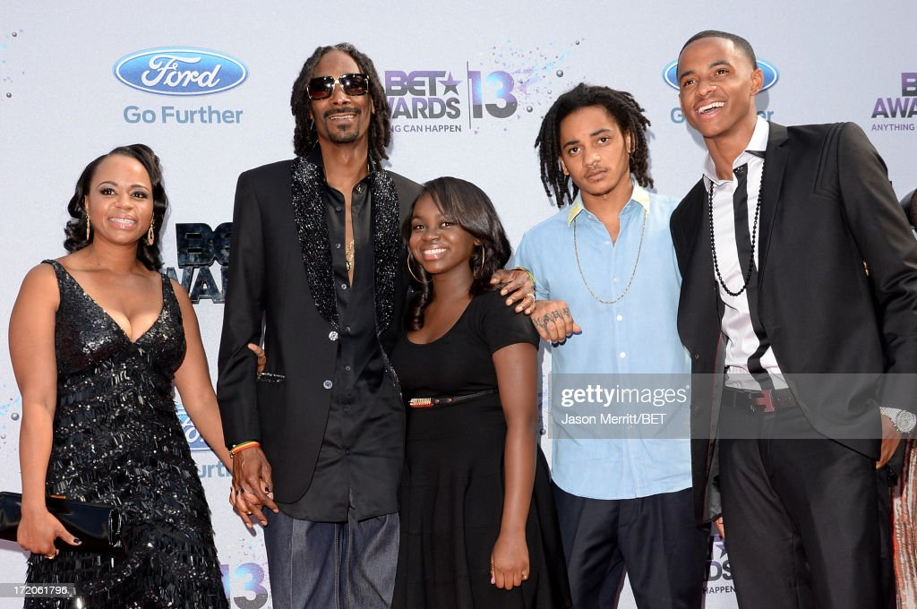 Recording Artist <a gi-track='captionPersonalityLinkClicked' href=/galleries/search?phrase=Snoop+Dogg&family=editorial&specificpeople=175943 ng-click='$event.stopPropagation()'>Snoop Dogg</a> (2nd from L) and guests attend the Ford Red Carpet at the 2013 BET Awards at Nokia Theatre L.A. Live on June 30, 2013 in Los Angeles, California.