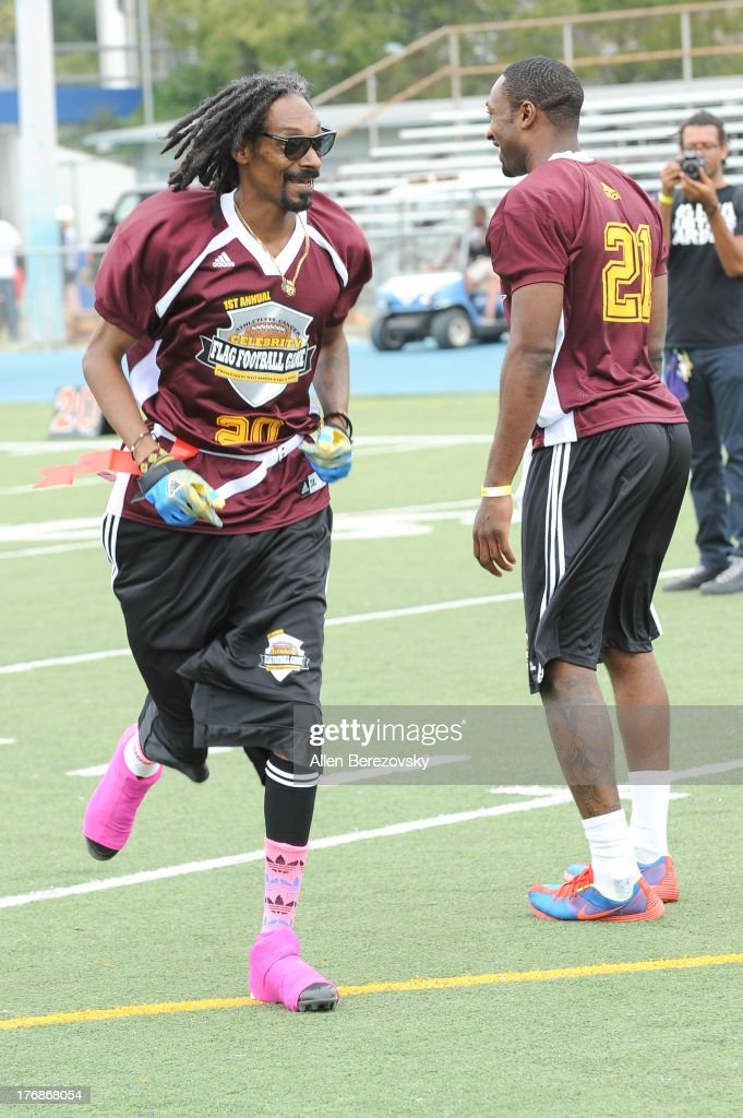 Recording artist Snoop Dogg (L) and NBA player Gilbert Arenas participate in the 1st Annual Athletes VS Cancer Celebrity Flag Football Game on August 18, 2013 in Pacific Palisades, California.