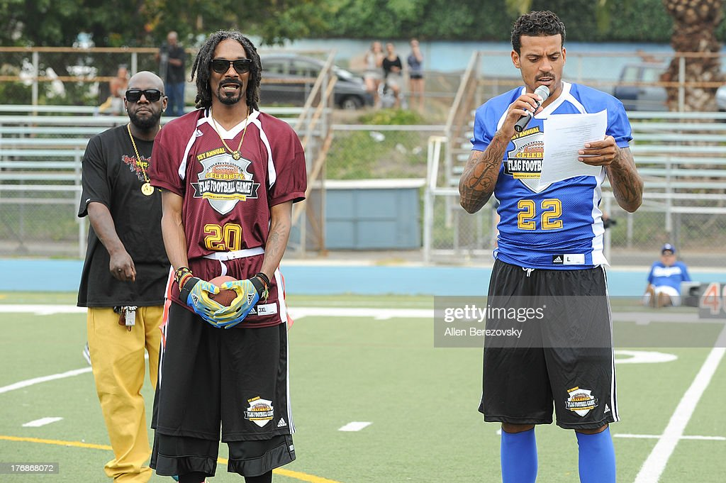 Recording artist Snoop Dogg (L) and NBA player Matt Barnes participate in the 1st Annual Athletes VS Cancer Celebrity Flag Football Game on August 18, 2013 in Pacific Palisades, California.
