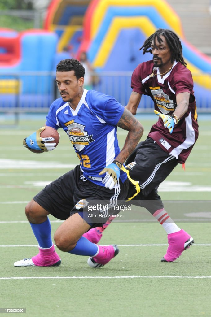 Recording artist Snoop Dogg (R) and NBA player Matt Barnes participate in the 1st Annual Athletes VS Cancer Celebrity Flag Football Game on August 18, 2013 in Pacific Palisades, California.