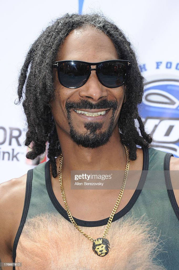 recording artist <a gi-track='captionPersonalityLinkClicked' href=/galleries/search?phrase=Snoop+Dogg&family=editorial&specificpeople=175943 ng-click='$event.stopPropagation()'>Snoop Dogg</a> attends the 1st Annual Athletes VS Cancer Celebrity Flag Football Game on August 18, 2013 in Pacific Palisades, California.
