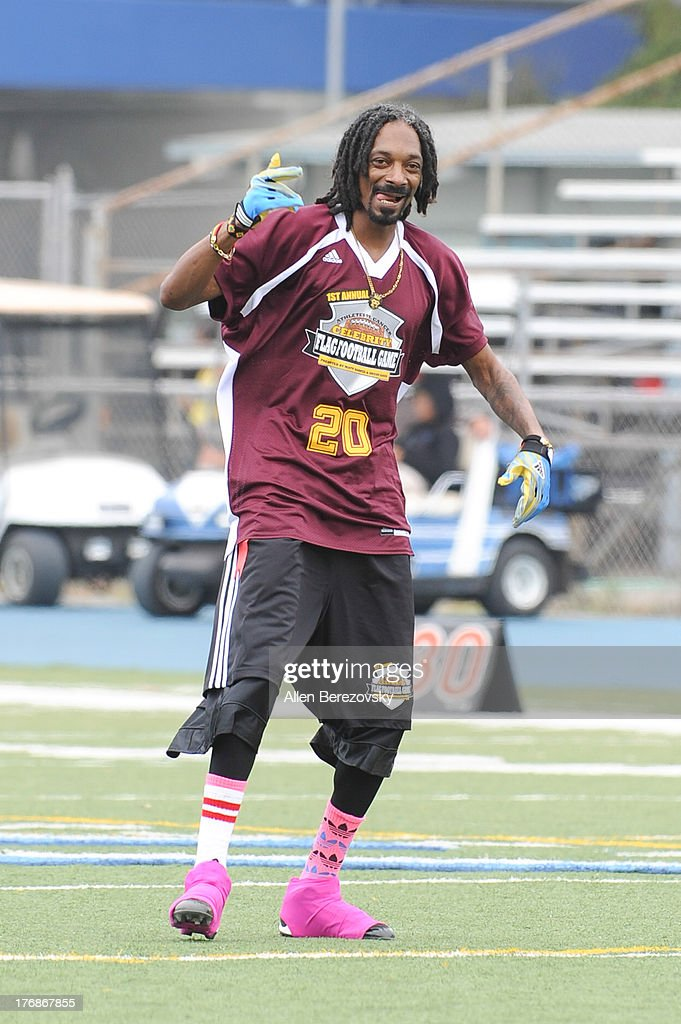 Recording artist Snoop Dogg participates in the 1st Annual Athletes VS Cancer Celebrity Flag Football Game on August 18, 2013 in Pacific Palisades, California.