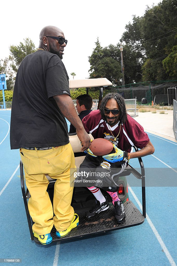 Recording artist Snoop Dogg (R) participates in the 1st Annual Athletes VS Cancer Celebrity Flag Football Game on August 18, 2013 in Pacific Palisades, California.