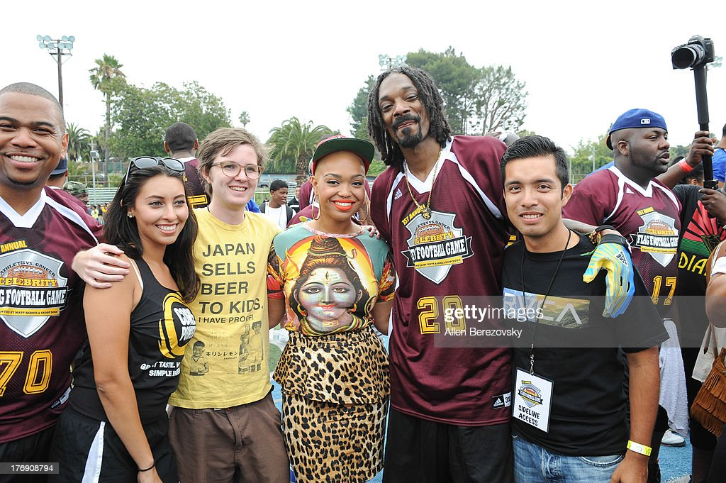 Recording artist Snoop Dogg poses for a picture with cancer survivors at the 1st Annual Athletes VS Cancer Celebrity Flag Football Game on August 18, 2013 in Pacific Palisades, California.
