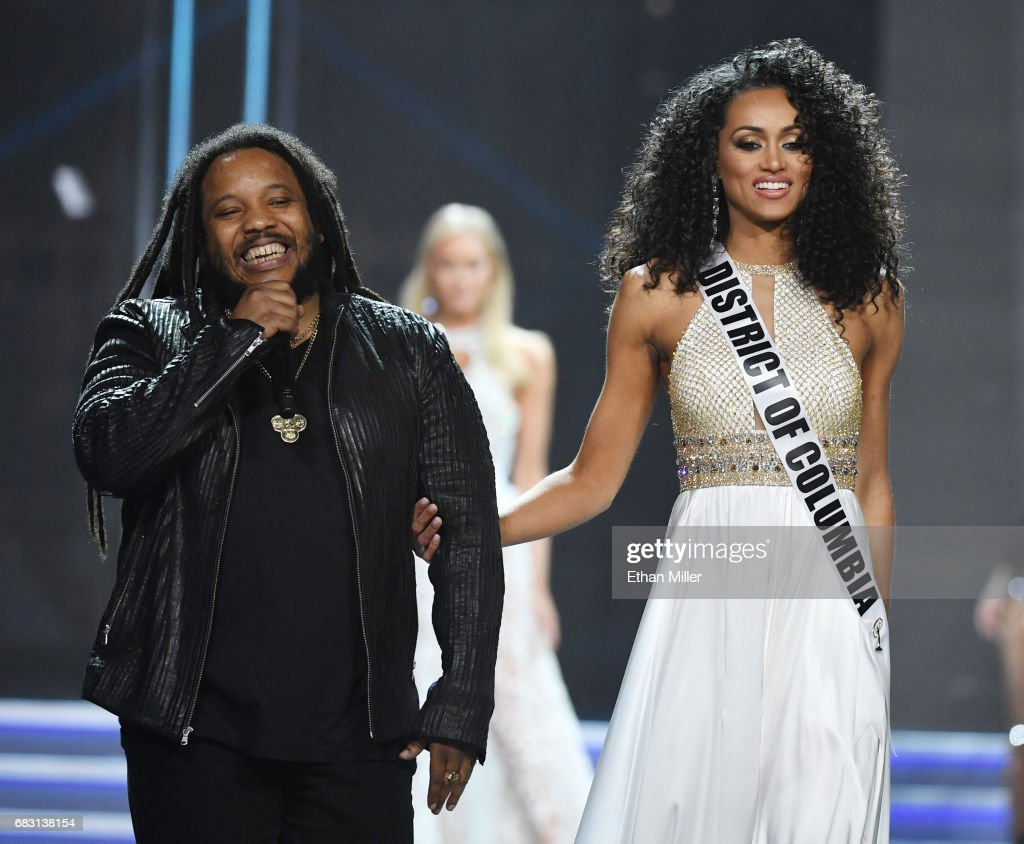 Recording artist Stephen Marley (L) performs while escorting Miss District of Columbia USA 2017 Kara McCullough onstage during the 2017 Miss USA pageant at the Mandalay Bay Events Center on May 14, 2017 in Las Vegas, Nevada. McCullough went on to be named the new Miss USA.