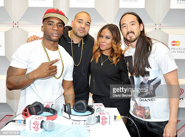 Recording artist Steve Aoki poses with radio personalities Charlamagne Tha God DJ Envy and Angela Yee of the Breakfast Club during the 2014...