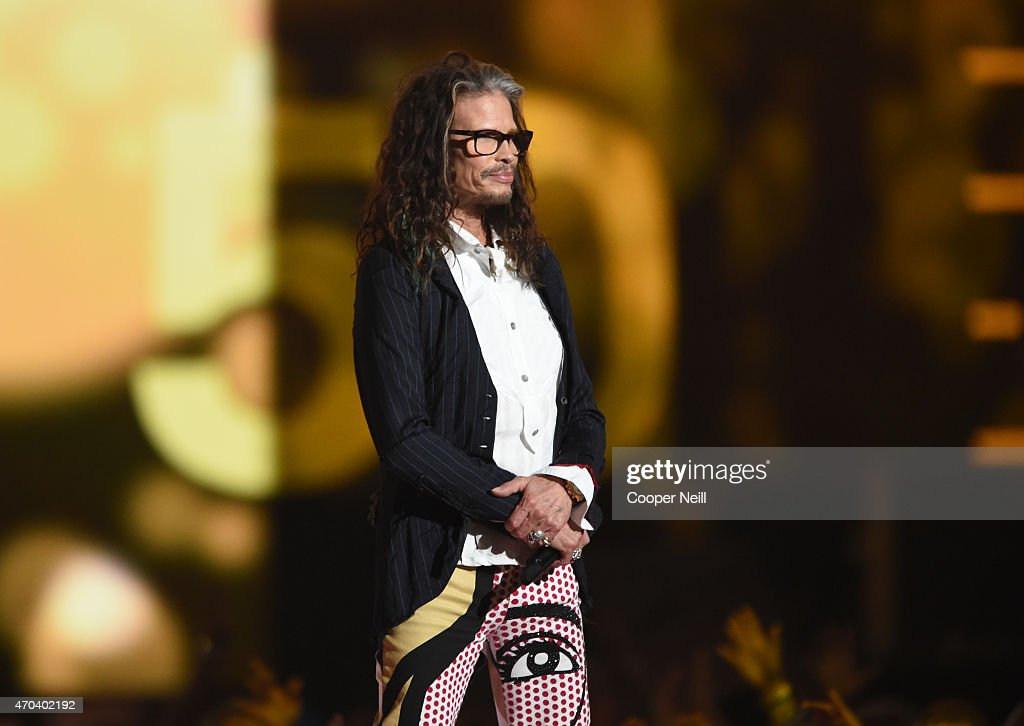Recording artist Steven Tyler of music group Aerosmith speaks onstage during the 50th Academy of Country Music Awards at ATT Stadium on April 19 2015...