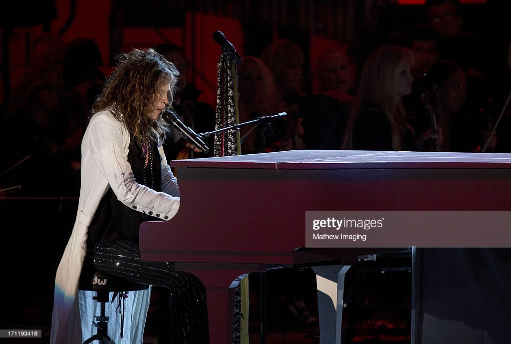 Recording artist <a gi-track='captionPersonalityLinkClicked' href=/galleries/search?phrase=Steven+Tyler&family=editorial&specificpeople=202080 ng-click='$event.stopPropagation()'>Steven Tyler</a> performs at Hollywood Bowl Opening Night Gala - Inside at The Hollywood Bowl on June 22, 2013 in Los Angeles, California.