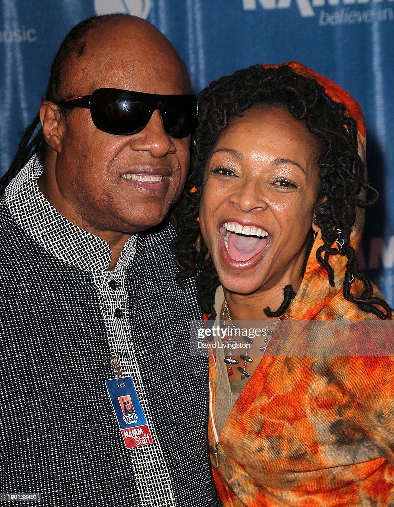 Recording artist Stevie Wonder (L) and songwriter Siedah Garrett attend the 2013 NAMM Show - Day 3 at the Anaheim Convention Center on January 26, 2013 in Anaheim, California.