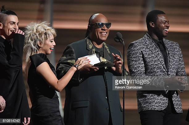Recording artist Stevie Wonder and the Pentatonix present award for Song of the Year onstage during The 58th GRAMMY Awards at Staples Center on...
