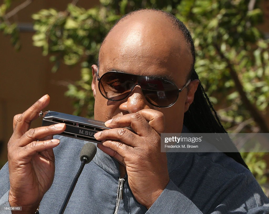 Recording artist <a gi-track='captionPersonalityLinkClicked' href=/galleries/search?phrase=Stevie+Wonder&family=editorial&specificpeople=171911 ng-click='$event.stopPropagation()'>Stevie Wonder</a> performs during the ceremony honoring The Funk Brothers on The Hollywood Walk Of Fame on March 21, 2013 in Hollywood, California.