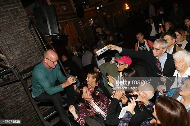 Recording artist Sting sign autographs for fans during The New Yorker Festival 2014 'The Last Ship' Panel at the Neil Simon Theater on October 11...