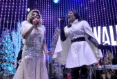 Recording artist Tamar Braxton is joined by sister Trina Braxton to perform in the Tree Lighting Ceremony at Universal CityWalk on December 5 2013 in...