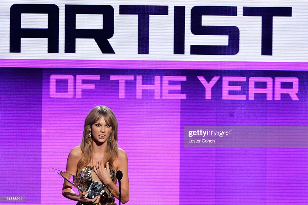 Recording artist <a gi-track='captionPersonalityLinkClicked' href=/galleries/search?phrase=Taylor+Swift&family=editorial&specificpeople=619504 ng-click='$event.stopPropagation()'>Taylor Swift</a> accepts the Artist of the Year award onstage during the 2013 American Music Awards at Nokia Theatre L.A. Live on November 24, 2013 in Los Angeles, California.