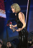 Recording artist Taylor Swift accepts the award for 'Female Artist of the Year' onstage at the iHeartRadio Music Awards which broadcasted live on TBS...