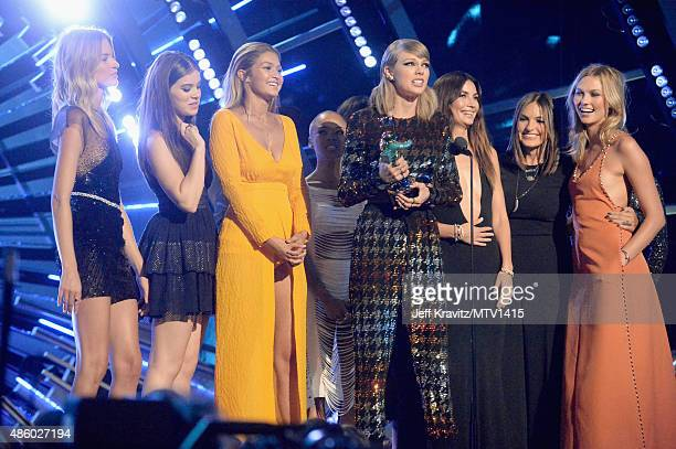 Recording artist Taylor Swift accepts the Video of the Year award for 'Bad Blood' with onstage video cast model Martha Hunt actress Hailee Steinfeld...