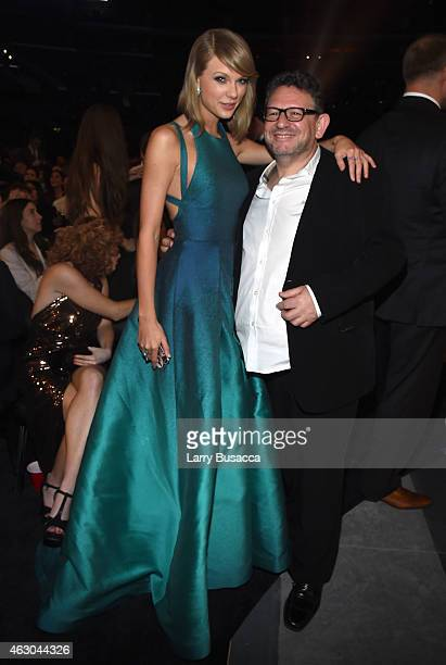 Recording artist Taylor Swift and UMG Worldwide CEO Lucian Grainge attend The 57th Annual GRAMMY Awards at the STAPLES Center on February 8 2015 in...