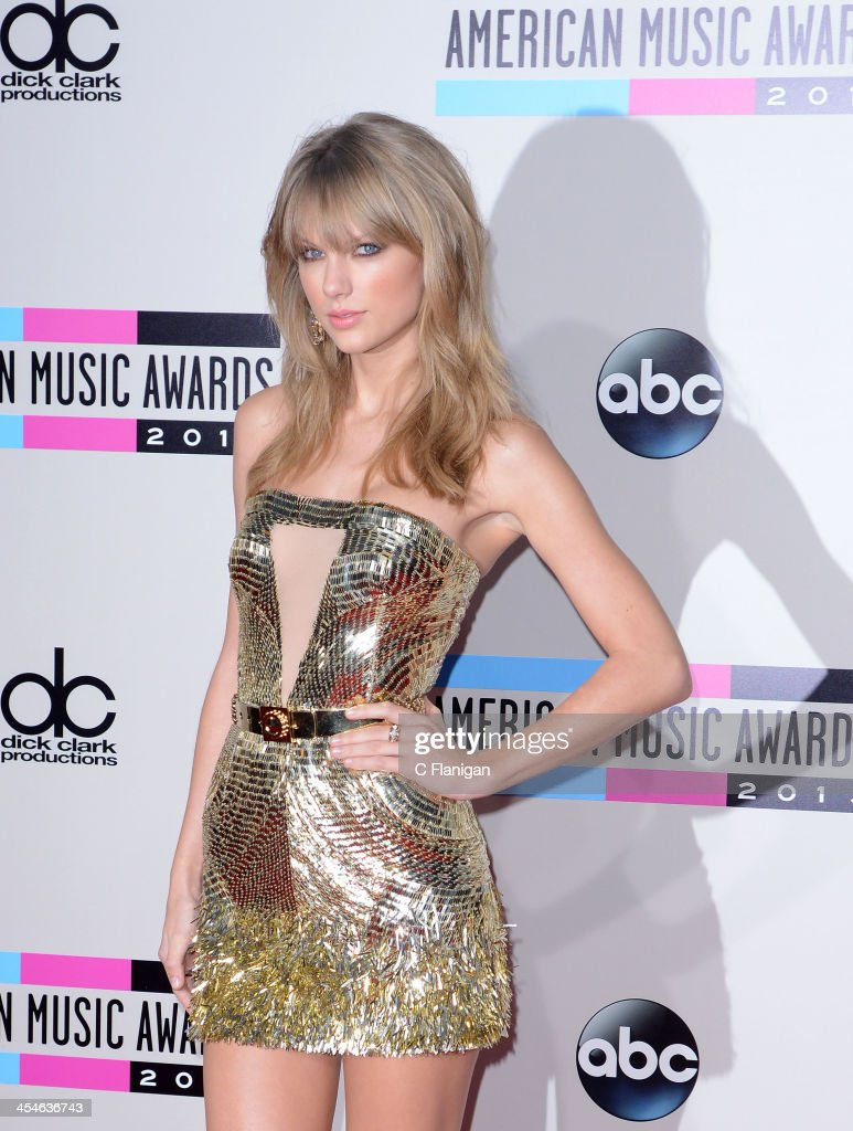Recording artist <a gi-track='captionPersonalityLinkClicked' href=/galleries/search?phrase=Taylor+Swift&family=editorial&specificpeople=619504 ng-click='$event.stopPropagation()'>Taylor Swift</a> arrives at the 2013 American Music Awards at Nokia Theatre L.A. Live on November 24, 2013 in Los Angeles, California.