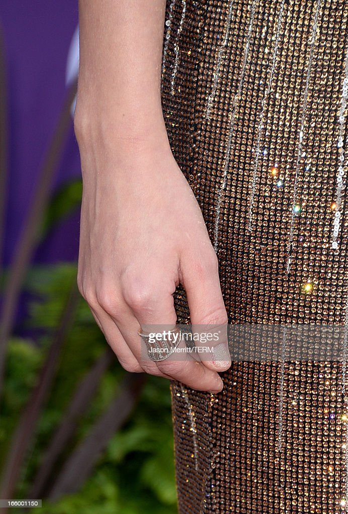 Recording artist Taylor Swift (jewlery detail) arrives at the 48th Annual Academy of Country Music Awards at the MGM Grand Garden Arena on April 7, 2013 in Las Vegas, Nevada.