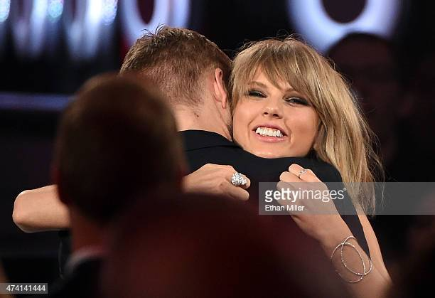 Recording artist Taylor Swift embraces DJ/producer Calvin Harris after she won the Top Billboard 200 Album award during the 2015 Billboard Music...