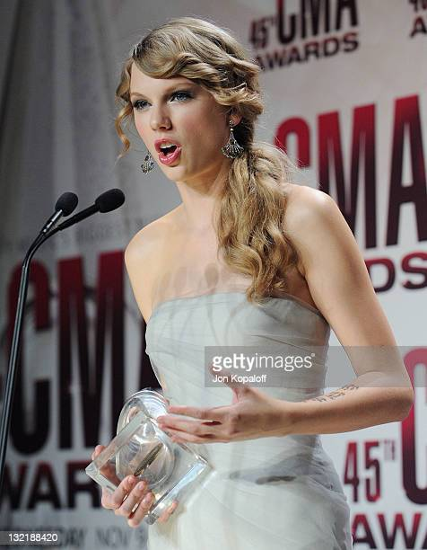 Recording artist Taylor Swift poses in the press room at the 45th annual CMA Awards at the Bridgestone Arena on November 9 2011 in Nashville Tennessee