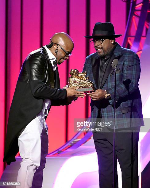 Recording artist Teddy Riley accepts the Legend Award from actor/comedian Cedric the Entertainer onstage during the 2016 Soul Train Music Awards on...