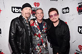 Recording artist The Edge radio personality Elvis Duran and recording artist Bono pose in the broadcast room during the iHeartRadio Music Awards at...