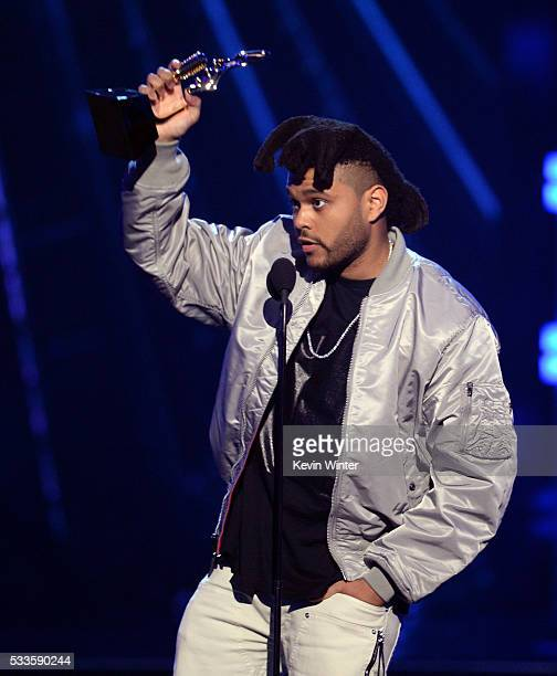 Recording artist The Weeknd accepts the Top Hot 100 Artist award onstage during the 2016 Billboard Music Awards at TMobile Arena on May 22 2016 in...