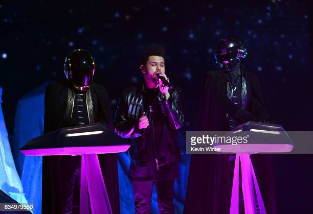 Recording artist The Weeknd and music group Daft Punk perform onstage during The 59th GRAMMY Awards at STAPLES Center on February 12 2017 in Los...