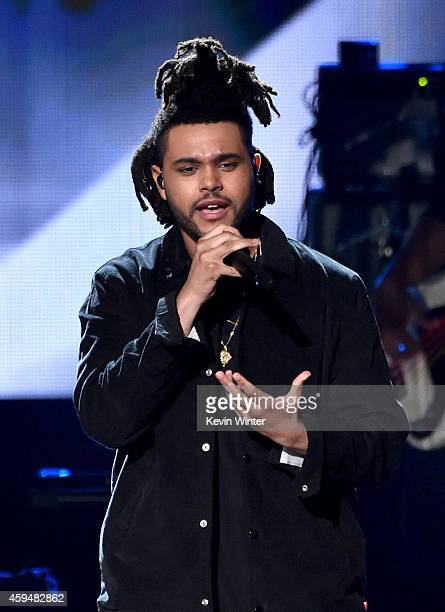Recording artist The Weeknd performs onstage at the 2014 American Music Awards at Nokia Theatre LA Live on November 23 2014 in Los Angeles California