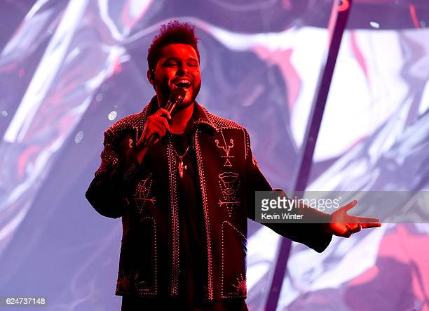 Recording artist The Weeknd performs onstage during the 2016 American Music Awards at Microsoft Theater on November 20 2016 in Los Angeles California
