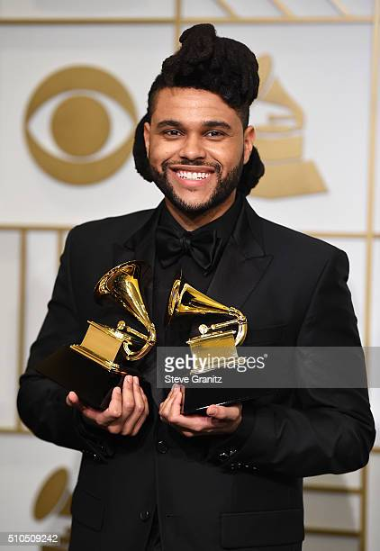 Recording artist The Weeknd winner of the Best RB Performance award for 'Earned It ' and Best Urban Contemporary Album award for 'Beauty Behind the...